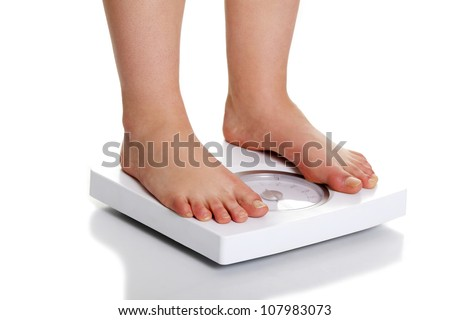 Standing on the weight. Isolated on white background.