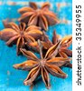 Star anise spice on rustic wooden table - stock photo