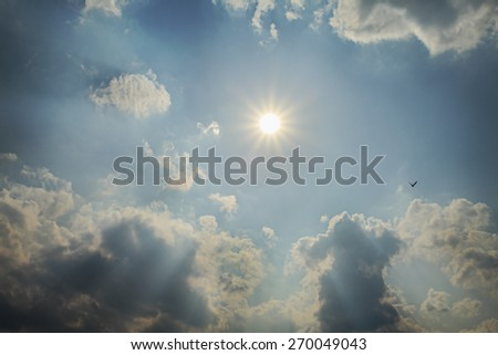 star cloudy sky blue cumulus sun ray ship silhouette