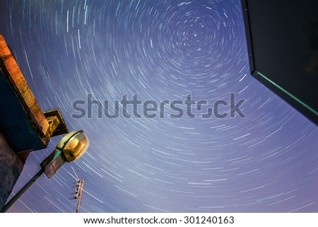 star trails on the background buildings