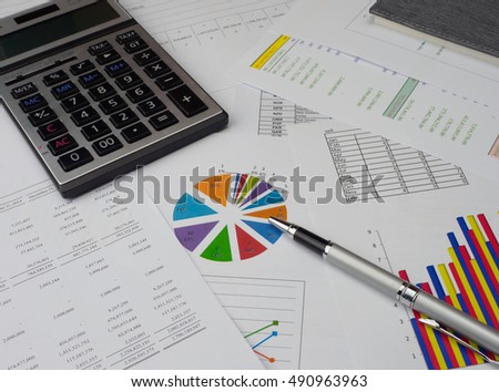 Statements of financial position.information with financial and sale graph.calculator, graph and pen on the desk. closeup graph on the table