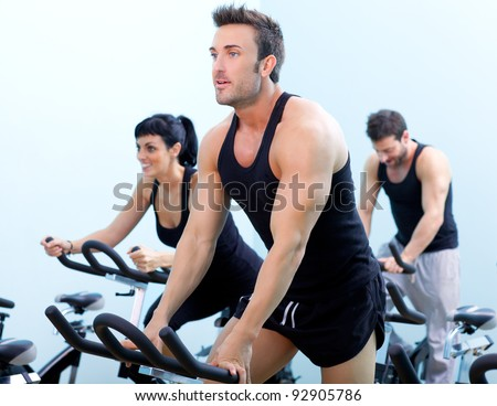 Stationary bicycles fitness man in a gym sport club