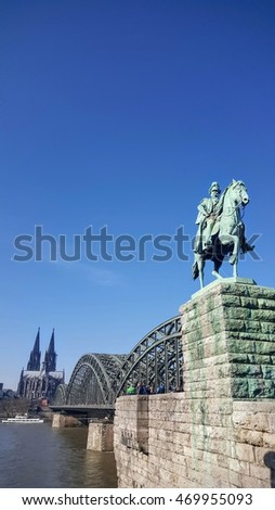 Statue and Colonge bridge with clear blue sky in weekend in Germany