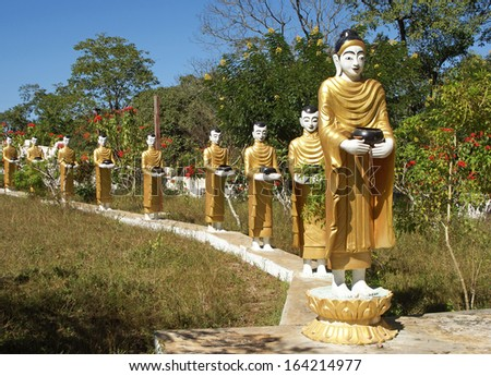 Statues of Buddha and his followers, Myanmar, Asia