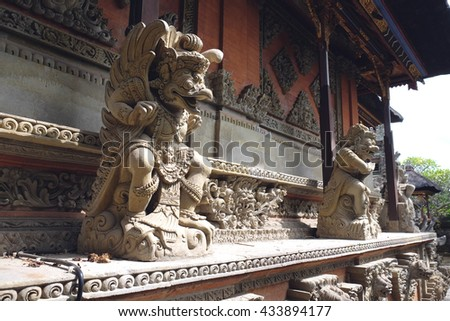 Statues of Hindu God or demons with offerings, traditional Balinese God sculpture in Bali temple, Indonesia