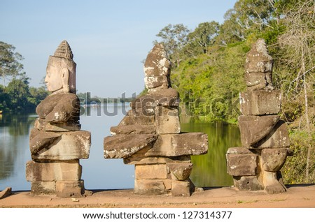Statues on the bridge, South Gate to Angkor Thom Temple, Cambodia