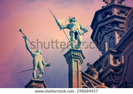 Statues on the roof of King's House or Maison du Roi on Grand Place in Brussels, with vintage look effects applied