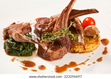 Steak of lamb with potatoes and spinach