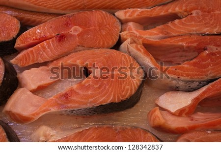 Steaks fresh fish salmon lying on the ice