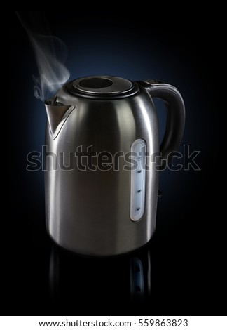 Steaming hot modern electric Kettle with reflections on dark background.