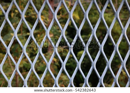 Steel cage or Seamless fence grid pattern.