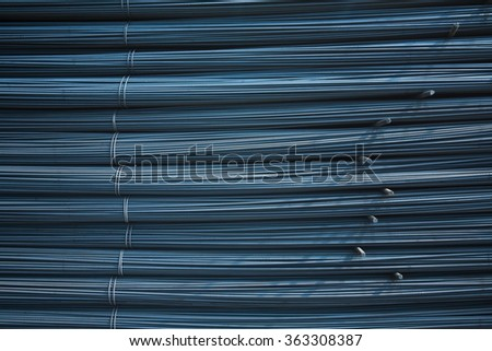 Steel rods or bars used to reinforce concrete. macro with shallow depth of field. background