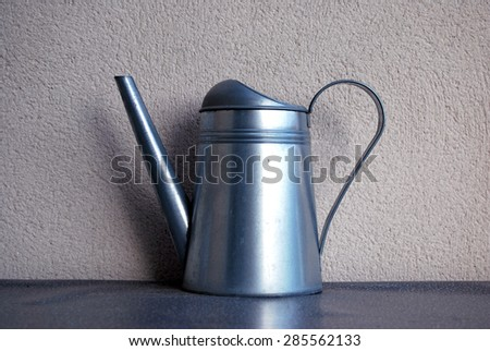 Steel watering can.