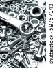 Steel wrench on nuts and bolts - stock photo