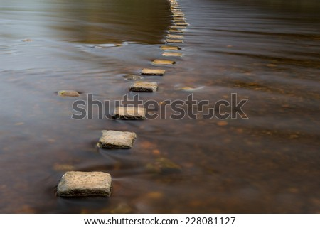 Stepping stones over a river.