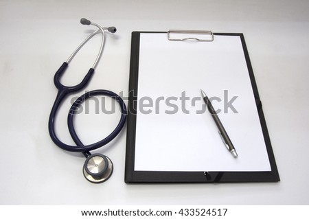 Stethoscope and blank clipboard with a sheet of white paper.