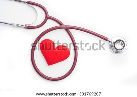 Stethoscope and red heart on white background.