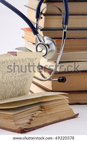 stethoscope on a  books