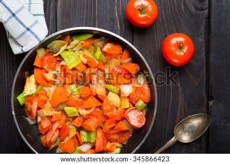 Stewed vegetables, mix of carrot, tomatoes and pepper. Vegetarian garnish