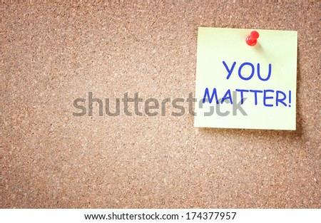 sticky note pinned to cork board with the phrase you matter.