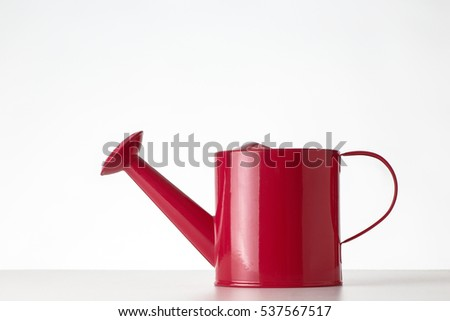 still life image of watering can