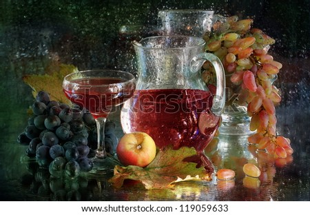 Still-life, juicy sweet grapes and glass of red fragrant wine