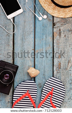 Still life of different items for relaxing on the beach, rubber flip-flops,