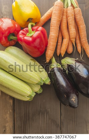 Still life of vegetables carrots courgettes peppers and eggplants