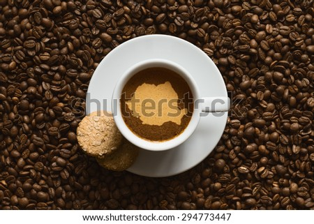 Still life photography of hot coffee beverage with map of Romania