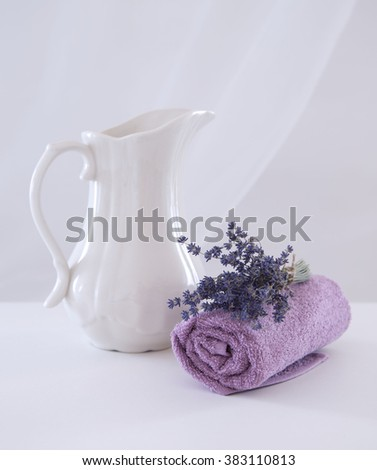 Still life with a jug to wash, towel and lavender bouquet