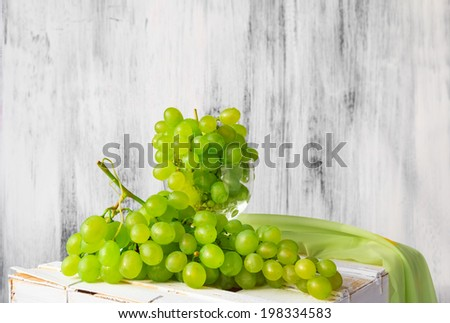 Still life with fruit and a bottle of wine grapes