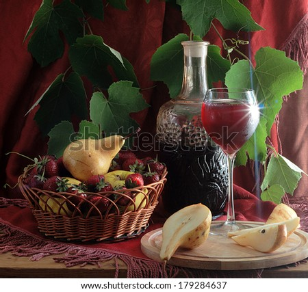 Still-life with fruit and red wine, fresh juicy appetizing fruit and berries in a wattled vase and fragrant red wine in a graceful glass