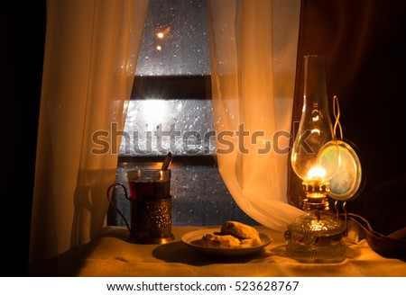 Still life with kerosene lamp near the window