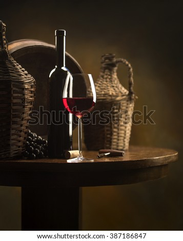 still life with red wine on wood table