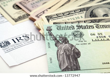 Stimulus economic tax return check and USA currency