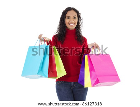 Stock image of cheerful woman holding shopping bags over white background