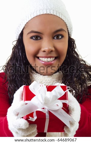 Stock image of female holding gift. Wearing winter clothing.