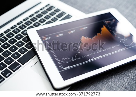 Stock market chart on digital tablet pc