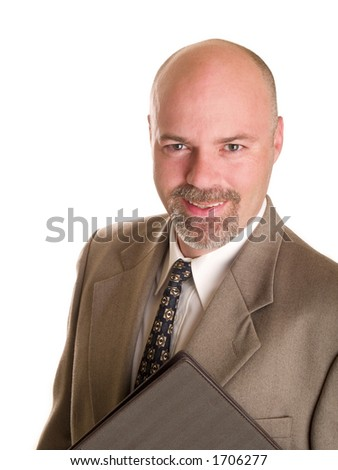 Stock photo of a well dressed businessman holding a notebook, isolated on white.