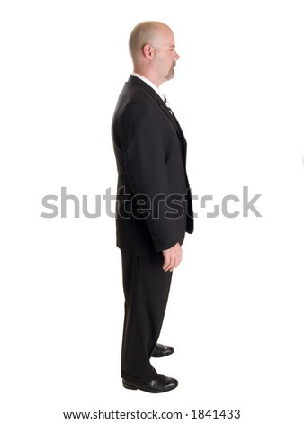 Stock photo of the side view profile of a well dressed businessman.  Full length, isolated white.