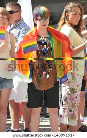 STOCKHOLM - AUGUST 03: A viewer at Gay Pride Parade in Stockholm, Sweden, on August 03, 2013, the biggest pride parade in Scandinavia