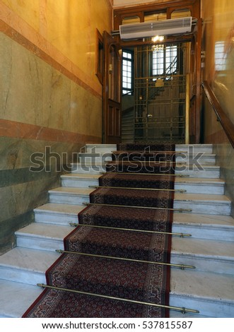 STOCKHOLM-SEPT.8:Entry steps to old, historic Bentleys Hotel building with antique elevator as seen in Stockholm, Sweden on September 8, 2016.