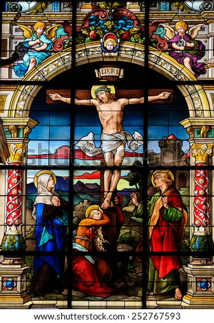 STOCKHOLM, SWEDEN - APRIL 16, 2010:  Beautiful stained glass window created by F. Zettler (1878-1911) at the German Church in Stockholm, depicting Jesus on the Cross on Good Friday.