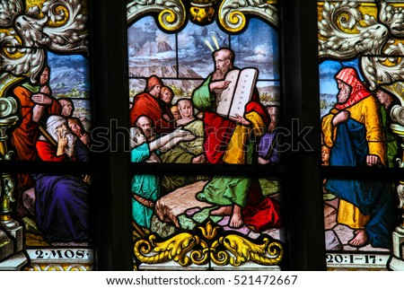 STOCKHOLM, SWEDEN - APRIL 16, 2010: Stained glass window depicting Moses showing the Stone Tablets with the Ten Commandments, in Saint James's Church in Stockholm, Sweden.