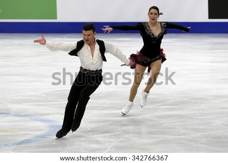 STOCKHOLM, SWEDEN - JANUARY 28, 2015: Charlene GUIGNARD / Marco FABBRI of Italy perform short dance at ISU European Figure Skating Championship in Globen Arena.