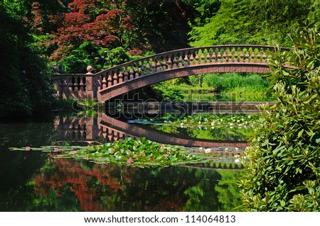 stone bridge old stone bridge spanning a pond in the japanese garden of the former hunting