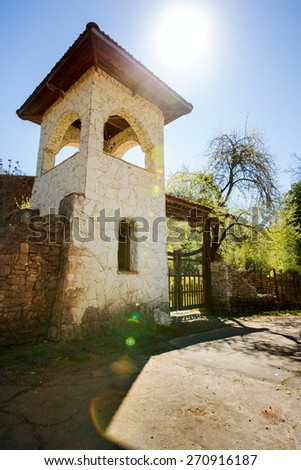 Stone tower with a fence against the sky