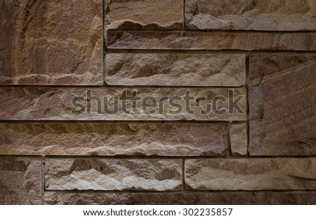 Stone wall background with light