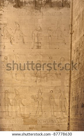 stone wall detail with reliefs at the ancient Temple of Edfu in Egypt (Africa)