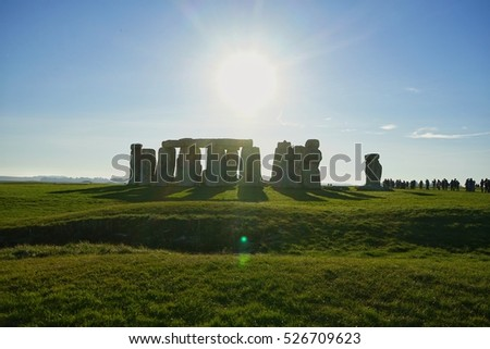 Stonehenge England.The mysterious and ancient Unesco World Heritage Site at Salisbury Plain, UK, England. Massive standing megalith stones with Sun at background and lens flare effect
